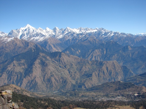 View of the village and the peaks during the trek. The helipad is seen on the extreme right.